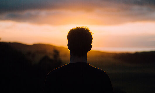 Man Looking into Sunset
